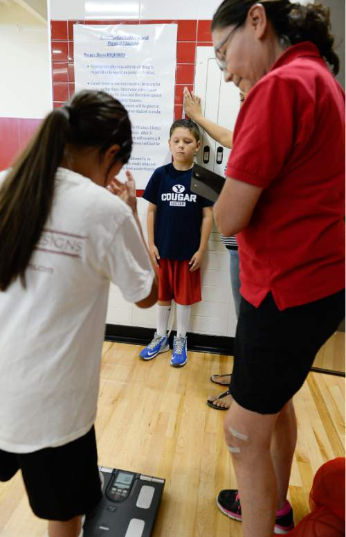 Francisco Kjolseth | The Salt Lake Tribune Certified Personal Trainer Gay Dawn Pinnecoose, right, with the Urban Indian Center, takes down basic health information as part of a diabetes prevention program run in partnership with a basketball camp for American Indian youth.