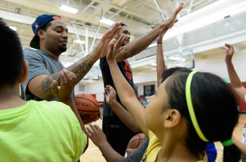 Francisco Kjolseth | The Salt Lake Tribune American Indian students get high-fives from their instructors following a morning of a self-esteem-boosting basketball program run by the Urban Indian Center, for American Indian youths grade 4 to 6.