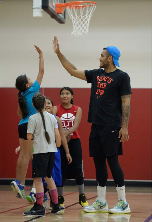 Francisco Kjolseth | The Salt Lake Tribune American basketball star Damen Bell-Holter gets high-fives from American Indian students getting a chance to participate in program that helps mixed race students who don't normally qualify for official federal funding.