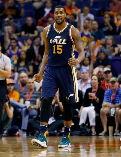 Utah Jazz forward Derrick Favors (15) reacts to a basket during the second half of an NBA basketball game against the Phoenix Suns, Sunday, April 3, 2016, in Phoenix. (AP Photo/Matt York)