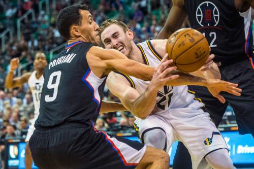 Chris Detrick  |  The Salt Lake Tribune Los Angeles Clippers guard Pablo Prigioni (9) and Utah Jazz forward Gordon Hayward (20) go for a rebound during the game at Vivint Smart Home Arena Friday April 8, 2016. Los Angeles Clippers defeated the Utah Jazz 102-99 in overtime.