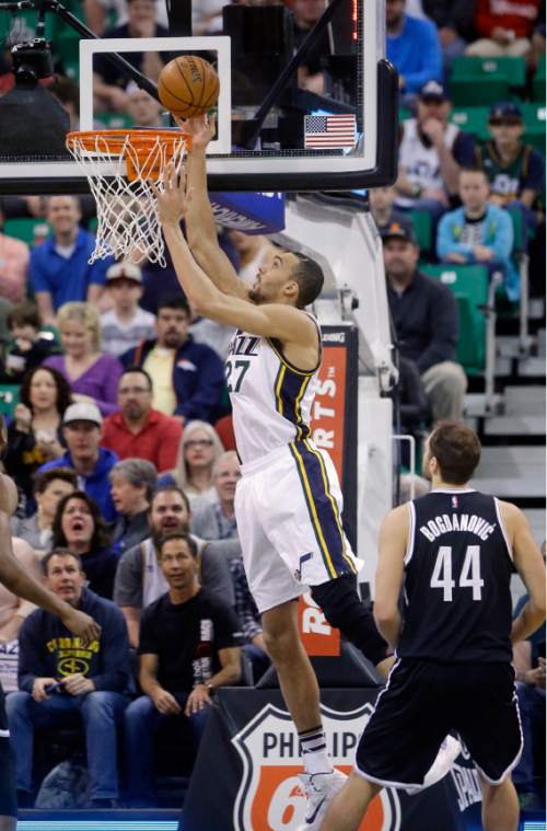 Utah Jazz center Rudy Gobert (27) goes to the basket as Brooklyn Nets guard Bojan Bogdanovic (44) watches during the first quarter of an NBA basketball game Saturday, Feb. 27, 2016, in Salt Lake City. (AP Photo/Rick Bowmer)