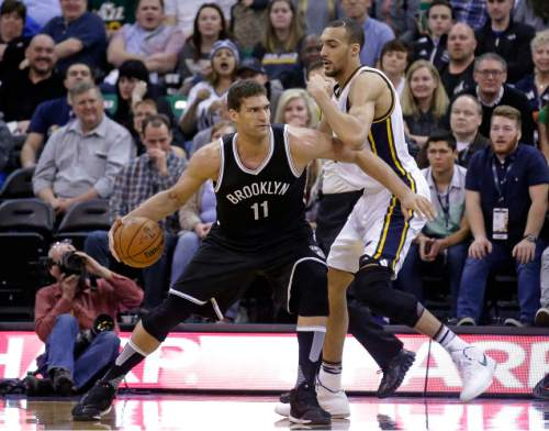 Brooklyn Nets center Brook Lopez (11) drives against Utah Jazz center Rudy Gobert, right, during the second half in an NBA basketball game Saturday, Feb. 27, 2016, in Salt Lake City. (AP Photo/Rick Bowmer)