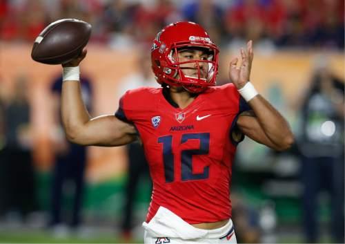 Arizona quarterback Anu Solomon throws during the first half of an NCAA college football game against BYU, Saturday, Sept. 3, 2016, in Phoenix. (AP Photo/Rick Scuteri)