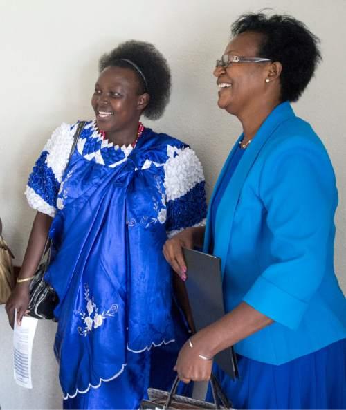 Rick Egan  |  The Salt Lake Tribune  Specy Namimana and Esperance Rugomwa visit between meetings at the Parleys Creek Swahili LDS Branch on Sunday, June 12, 2016.