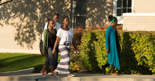 Leah Hogsten  |  The Salt Lake Tribune Members of the Swahili LDS Branch in Salt Lake City head into church for scripture study, Tuesday, August 16, 2016.  Most members are refugees from Kenya, Tanzania, Rwanda, Burundi, Uganda and the Congo. Church services are in Swahili, with at least one Sunday school class in English.
