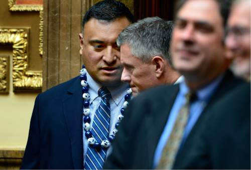 Scott Sommerdorf   |  The Salt Lake Tribune   BYU head football coach Kalani Sitake, left, leans in to speak to Utah head coach Kyle Whittingham as they both visited the Utah House of Representatives, Thursday, March 3, 2016. They were later both honored for their football accomplishments by an introduction on the floor.