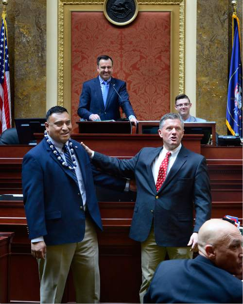 Scott Sommerdorf   |  The Salt Lake Tribune   BYU head football coach Kalani Sitake, left, and Utah head coach Kyle Whittingham are honored by being introduced in the Utah House of Representatives, Thursday, March 3, 2016. Speaker of the House Greg Hughes, R-Draper is in the background.