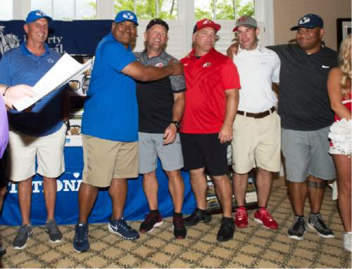 Steve Griffin / The Salt Lake Tribune  BYU head coach Kalani Sitake congratulates University of Utah head coach Kyle Whittingham as they announce the results of the rivalry for charity (National Kidney Foundation) golf tournament at Hidden Valley Country Club in Sandy, Utah Monday June 13, 2016. The tournament pitted the Utah football team coaches against the BYU football coaches with the losing team singing the others fight song. Sitake and his team held up their end of the bargain and sang the University of Utah fight song after falling to the Utah coaches in the tournament.