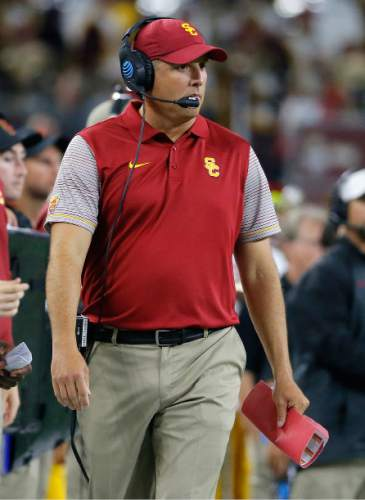Southern California coach Clay Helton watches from the sideline during the second half of the team's NCAA college football game against Alabama on Saturday, Sept. 3, 2016, in Arlington, Texas. (AP Photo/Tony Gutierrez)