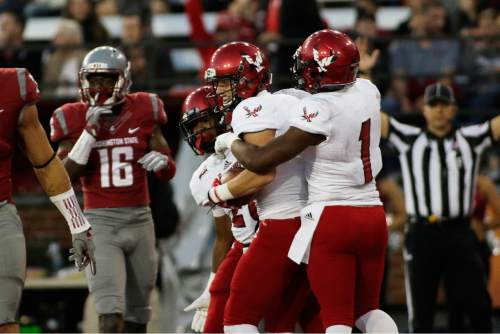 After scoring a touchdown, Eastern Washington wide receiver Cooper Kupp, center, celebrates with wide receiver Shaq Hill (1) and running back Antoine Custer Jr. during the second half of an NCAA college football game against Washington State in Pullman, Wash., Saturday, Sept. 3, 2016. Eastern Washington won 45-42. (AP Photo/Young Kwak)