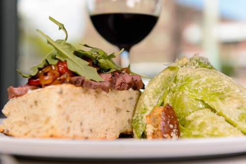 Trent Nelson  |  The Salt Lake Tribune Grilled Bavette Steak sandwich with caesar salad at Stanza, a new Italian restaurant in Salt Lake City, Friday September 2, 2016.