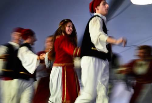 Scott Sommerdorf   |  The Salt Lake Tribune Dancers perform during the 2014 Greek Festival.