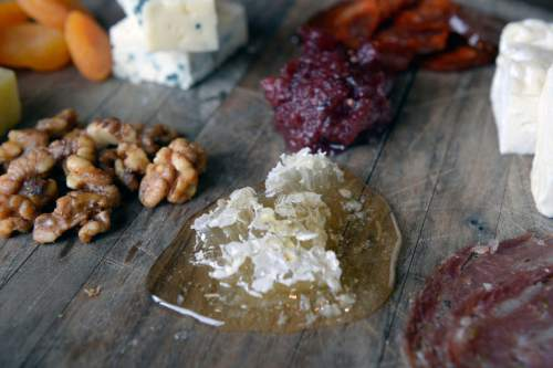 Al Hartmann     The Salt Lake Tribune Ryker Brown, the Executive Chef at the Waldorf Astoria,  tends to several beehives near the Park City resort and uses the raw honey  in dishes like this plate of local meats and cheeses.