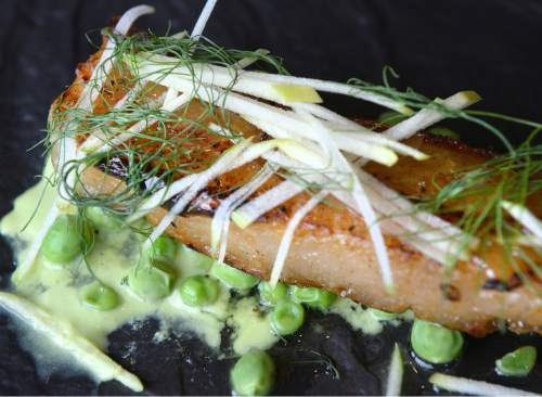 Al Hartmann     The Salt Lake Tribune Pork belly with fresh peas, drizzled with raw honey at Park City's Waldorf Astoria.