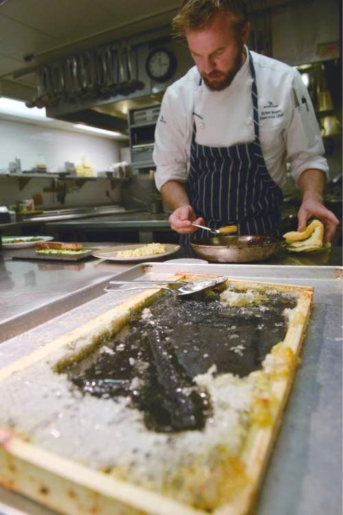 Al Hartmann     The Salt Lake Tribune Executive Chef Ryker Brown uses raw honey from a frame in dishes at Powder, the signature restaurant at the Waldorf Astoria in Park City.