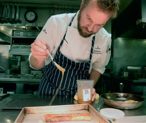 Al Hartmann     The Salt Lake Tribune Executive Chef Ryker Brown drizzles raw honey on the pork belly appetizer at Powder, the signature restaurant at the Waldorf Astoria in Park City.
