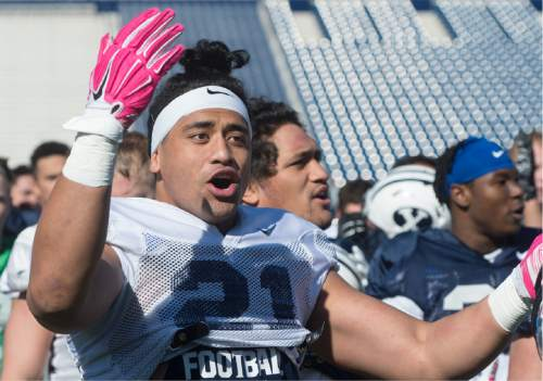 Rick Egan  |  The Salt Lake Tribune  Linebacker, Harvey Langi (21) sings the BYU Fight Song, during BYU's final practice of spring camp, at LaVell Edwards Stadium, Friday, April 1, 2016.