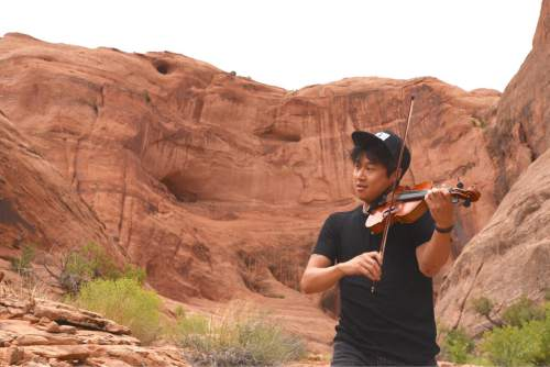 Lynn R. Johnson  |  Special to The Salt Lake Tribune  Violinist Charles Yang has been described as a classical violinist with the charisma of a rock star.  During the Music Hike I Concert at Moab's Middle Earth Canyon on Saturday, Sept. 3, Yang premiered his New Work for Solo Violin composition. The performance was part of the 2016 Moab Music Festival, which continues through Sept. 11.
