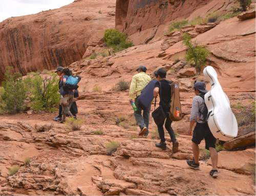 Lynn R. Johnson  |  Special to The Salt Lake Tribune  Musicians and patrons hike out of Moab's Middle Earth Canyon on Saturday, Sept. 3,  following the Music Hike I on the third day of the 2016 Moab Music Festival.