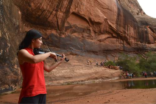 Lynn R. Johnson  |  Special to The Salt Lake Tribune  Harumi Rhodes performed at Moab's Middle Earth wilderness area during the first Music Hike of the 2016 Moab Music Festival (Saturday, Sept. 3). The performance was part of the 2016 Moab Music Festival, which continues through Sept. 12 in various locations.