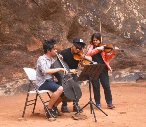 Lynn R. Johnson  |  Special to The Salt Lake Tribune  Following the Music Hike I Concert on Saturday, Sept. 3, 2016, Moab Music Festival artistic director Leslie Tomkins, far right, joined cellist Jay Campbell, left, and violinist Charles Yang to enjoy Moab's Middle Earth Canyon's unique acoustics for an informal musical improvisation.