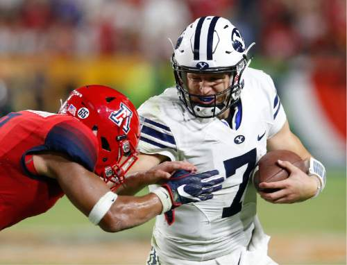 BYU quarterback Taysom Hill (7) fights for a first down during the second half of an NCAA college football game, Saturday, Sept. 3, 2016, in Phoenix. BYU defeated Arizona 18-16. (AP Photo/Rick Scuteri)