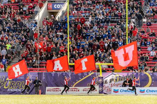 Trent Nelson  |  The Salt Lake Tribune Utah celebrates a first quarter touchdown as Utah faces BYU in the Royal Purple Las Vegas Bowl, NCAA football at Sam Boyd Stadium in Las Vegas, Saturday December 19, 2015.