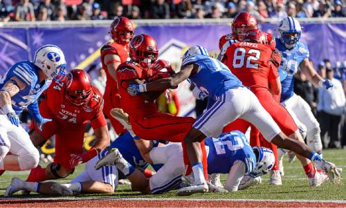 Trent Nelson  |  The Salt Lake Tribune Utah Utes running back Joe Williams (28) scores a touchdown as Utah faces BYU in the Royal Purple Las Vegas Bowl, NCAA football at Sam Boyd Stadium in Las Vegas, Saturday December 19, 2015.