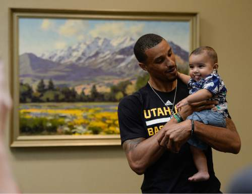 Francisco Kjolseth | The Salt Lake Tribune The Utah Jazz introduce their new point guard, George Hill, who snuggles his 5-month-old son Zayden. Hill was officially acquired from the Pacers yesterday after a deal was struck in the days leading up to the NBA draft.