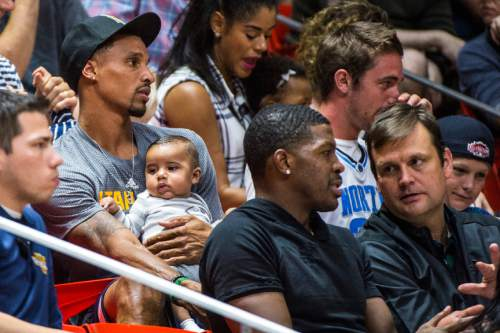 Chris Detrick  |  The Salt Lake Tribune Utah Jazz's George Hill watches the game as Joe Johnson talks with Dennis Lindsey at the Huntsman Center Thursday July 7, 2016. Philadelphia won the game 86-75.