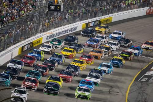 Drivers line up four-wide before the NASCAR Sprint Cup auto race at Richmond International Raceway in Richmond, Va., Saturday, Sept. 10, 2016. (AP Photo/Chet Strange)