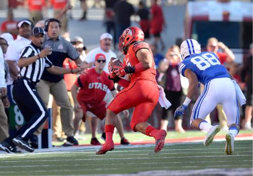 Scott Sommerdorf   |  The Salt Lake Tribune   Utah LB Sunia Tauteoli turns to run after he grabbed an interception after BYU WR Aleva Hifo bobbled the pass. Tauteoli rumbled 41 yards untouched for the TD on the game's opening play from scrimmage. Utah led BYU 7-6 after one quarter of play, Saturday, September 10, 2016.