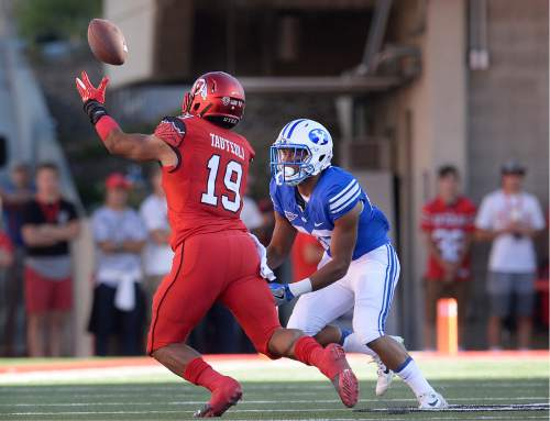 Scott Sommerdorf   |  The Salt Lake Tribune   Utah LB Sunia Tauteoli grabs an interception after BYU WR Aleva Hifo bobbled the pass. Tauteoli rumbled 41 yards untouched for the TD on the game's opening play from scrimmage. Utah led BYU 7-6 after one quarter of play, Saturday, September 10, 2016.