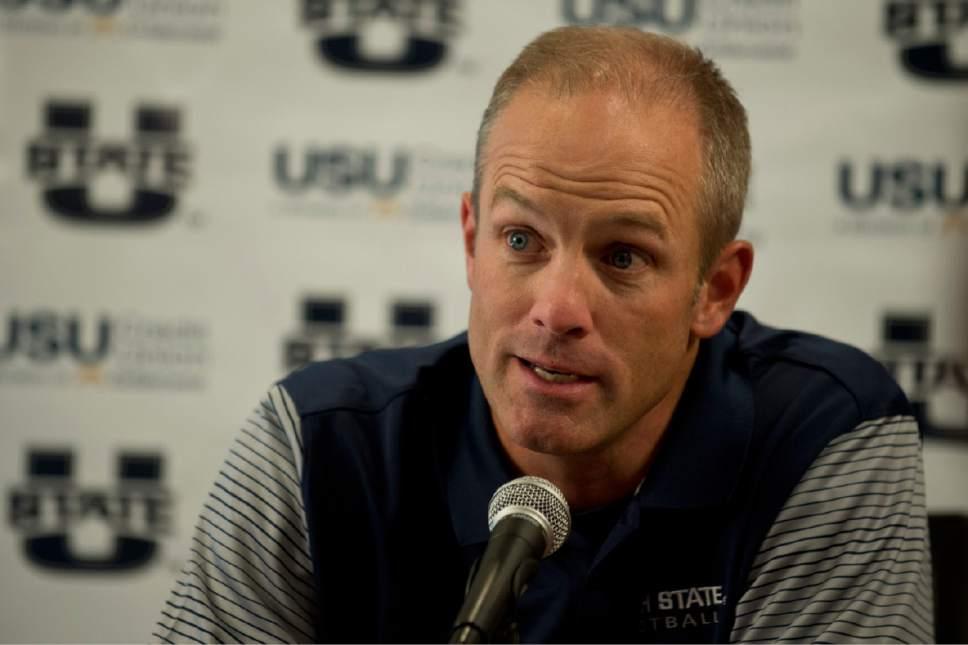 Lennie Mahler  |  The Salt Lake Tribune  Utah State University head football coach Matt Wells answers questions during media day in Logan, Utah, Thursday, Aug. 4, 2016.