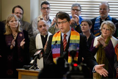 Scott Sommerdorf   |  The Salt Lake Tribune Pastor Curtis Price from Salt Lake's First Baptist Church speaks at a press conference about the need to pass SB 100 - Antidiscrimination Amendments, Thursday, February 12, 2015. Behind Price is a group of leaders from diverse faiths who came in support and who also spoke.