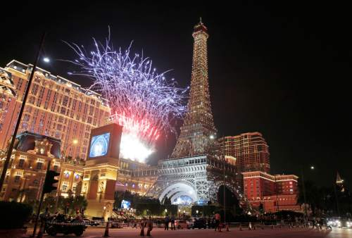 Fireworks explodes at a replica of the Eiffel Tower of Parisian Macao during an opening ceremony in Macau, China, Tuesday, Sept. 13, 2016. The southern Chinese casino gambling powerhouse of Macau is getting a French twist. U.S. billionaire Sheldon Adelson is set to throw open the doors Tuesday to the French-themed Parisian Macao, the mogul's fifth property in the former Portuguese colony. (AP Photo/Kin Cheung)