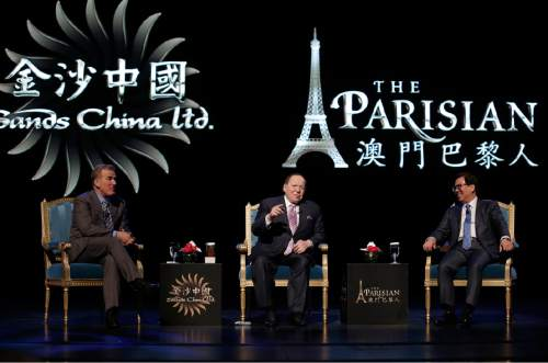 U.S. billionaire Sheldon Adelson, center, speaks between Las Vegas Sands Corporation President and Chief Operating Officer Robert Goldstein, left, and Sands China Ltd. President Wilfred Wong during a press conference for the opening of Parisian Macao in Macau, Tuesday, Sept. 13, 2016. Adelson was set to throw open the doors Tuesday to the French-themed Parisian Macao, the mogul's fifth property in the former Portuguese colony. (AP Photo/Kin Cheung)