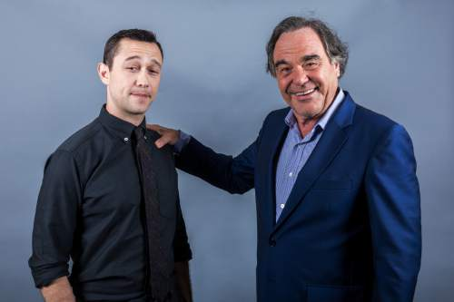 """In this Aug. 28, 2016 photo, Oliver Stone, right, and Joseph Gordon-Levitt pose for a portrait in promotion of """"Snowden"""" in Los Angeles. (Photo by Willy Sanjuan/Invision/AP)"""
