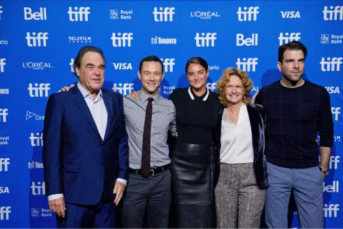 """Director Oliver Stone, left, and actors Joseph Gordon-Levitt, Shailene Woodley, Melissa Leo and Zachary Quinto pose for a photo during a press conference for """"Snowden"""" at the Toronto International Film Festival at the TIFF Bell Lightbox on Saturday, Sept. 10, 2016, in Toronto.  (Galit Rodan/The Canadian Press via AP)"""