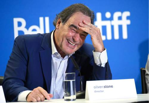 """Director Oliver Stone participates in the """"Snowden"""" press conference on day 3 of the Toronto International Film Festival at the TIFF Bell Lightbox on Saturday, Sept. 10, 2016, in Toronto. (Photo by Evan Agostini/Invision/AP)"""