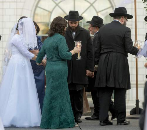 Rick Egan  |  The Salt Lake Tribune  Rabbi Mendy Cohen's new bride, Chaya Zippel, circles him seven times during their traditional Hasidic wedding ceremony Monday, Sept. 12, 2016.