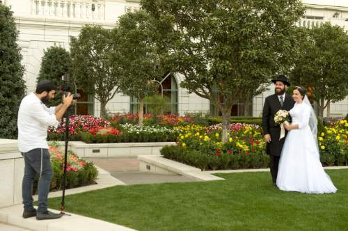 Rick Egan  |  The Salt Lake Tribune  Rabbi Mendy Cohen and Chaya Zippel pose for photos after their traditional Hasidic wedding ceremony at the Grand America on Monday, Sept. 12, 2016.
