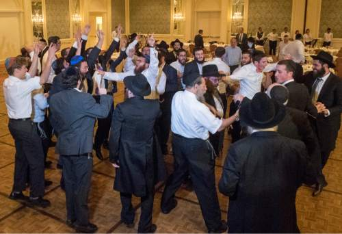 Rick Egan  |  The Salt Lake Tribune  Rabbi Mendy Cohen and the men dance during his traditional Hasidic wedding celebration at the Grand America after Cohen was married to Chaya Zippel on Monday, Sept. 12, 2016.