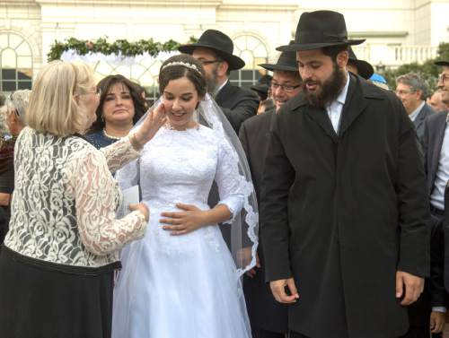 Rick Egan  |  The Salt Lake Tribune  Chaya Zippel and Rabbi Mendy Cohen are greeted by loved ones after their traditional Hasidic wedding ceremony at the Grand America on Monday, Sept. 12, 2016.