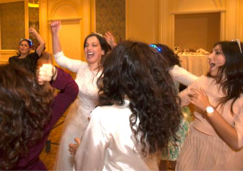 Rick Egan  |  The Salt Lake Tribune  Chaya Zippel, dances during her traditional Hasidic wedding celebration at the Grand America after she was married to Rabbi Mendy Cohen on Monday, Sept. 12, 2016.