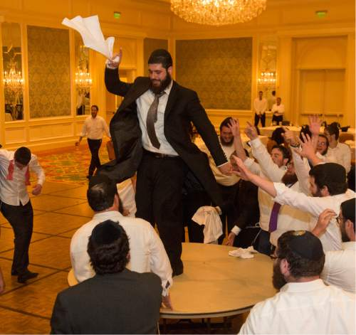 Rick Egan  |  The Salt Lake Tribune  Rabbi Mendy Cohen dances on a table during a traditional Hasidic wedding celebration at the Grand America after Cohen was married to Chaya Zippel on Monday, Sept. 12, 2016.