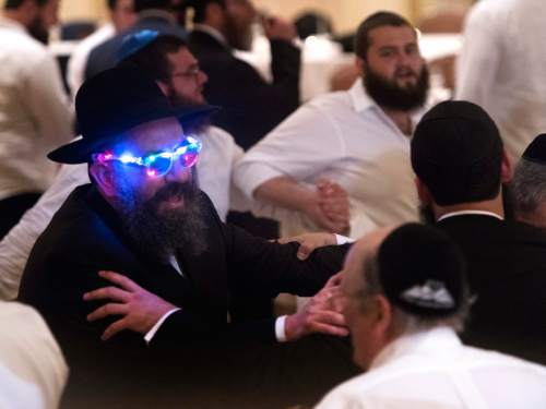 Rick Egan  |  The Salt Lake Tribune  Rabbi Benny Zippel wears funky glasses as he joins the dancing during the traditional Hasidic celebration for his daughter Chaya Zippel's marriage to Rabbi Mendy Cohen on Monday, Sept. 12, 2016.