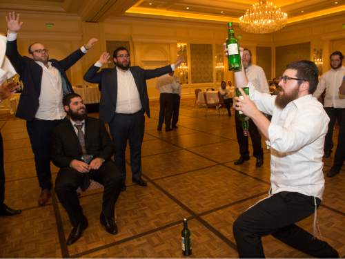 Rick Egan  |  The Salt Lake Tribune  Nochum Greenwald, of Montreal, does a bottle-balancing trick during the traditional Hasidic wedding celebration at the Grand America on Monday, Sept. 12, 2016.