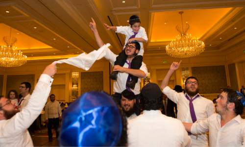 Rick Egan  |  The Salt Lake Tribune  The men and boys dance as they celebrate during a traditional Hasidic wedding at the Grand America after Rabbi Mendy Cohen married Chaya Zippel on Monday, Sept. 12, 2016.
